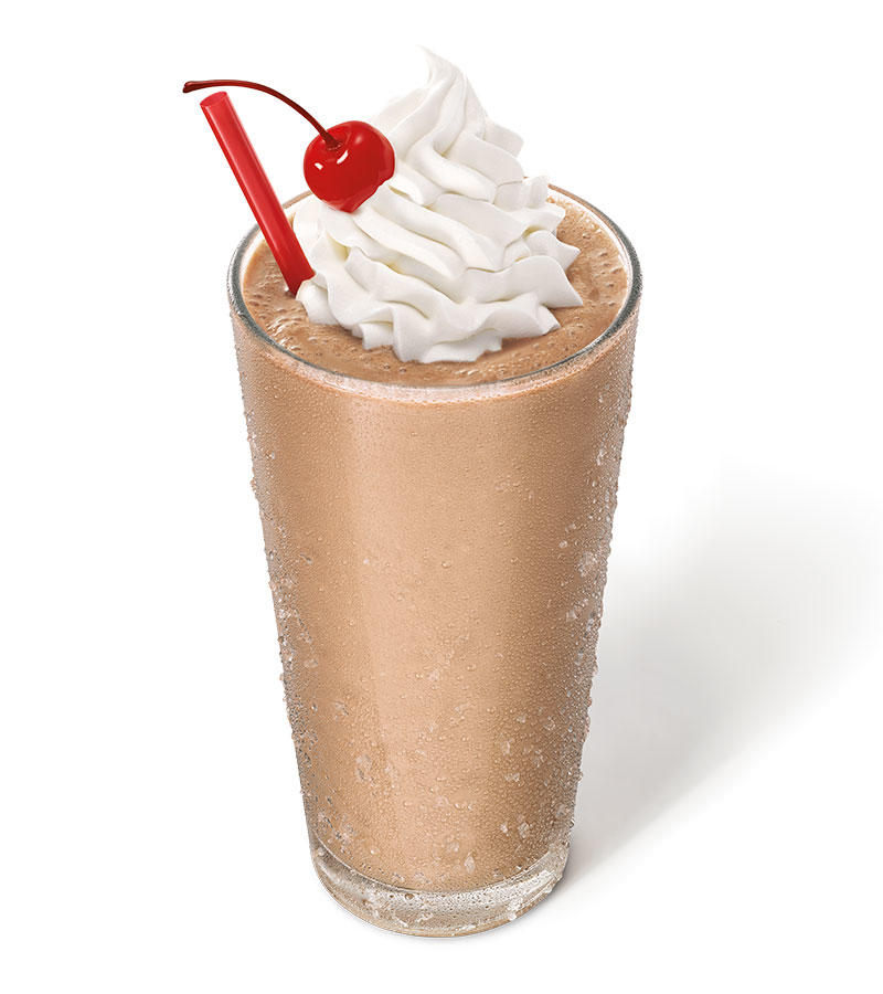 Hand-mixed, Real Ice Cream Shakes have a classic look with a rich chocolate flavor, finished with whipped topping and a cherry.