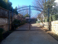 Looking for a high-end driveway gate? Buzz installs custom iron gates that can open automatically!