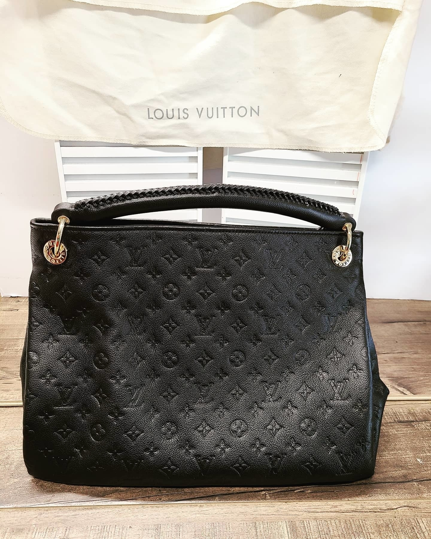 KW Shoe Repair & Sneaker Cleaning Service in Kitchener: Both rings where straps are are connected are installed  and fixed to this Louis Vuitton luxury handbag!