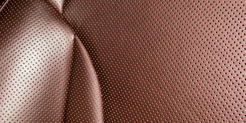 Perforated automotive materials elevate luxury and comfort.