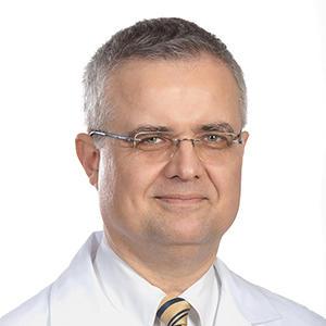 Janusz M Dudek MD