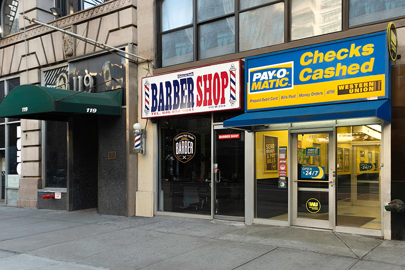 Exterior view from sidewalk of PAYOMATIC store located at 115 West 23rd St New York, NY 10011