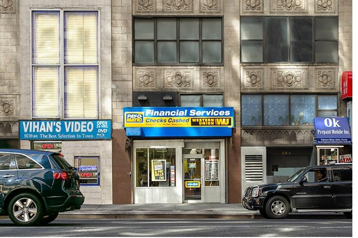 Exterior view from street of PAYOMATIC store located at 590 Eight Ave New York, NY 10018