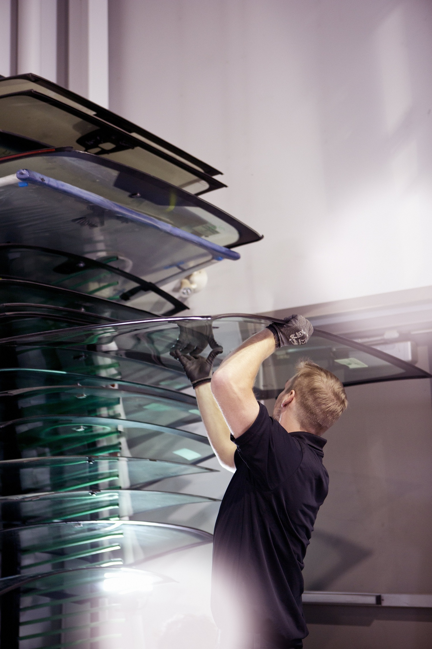 Speedy Glass in Cambridge: A Speedy Glass technician choosing a windshield to replace it