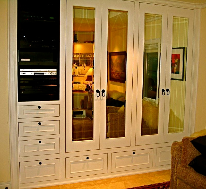 His, built in custom closet features integrated hi fi system, beveled mirror doors, aromatic Cedar lining throughout, tie rack, interior lighting, jewelry drawer in interior Redwood drawer system and shoe rack.
