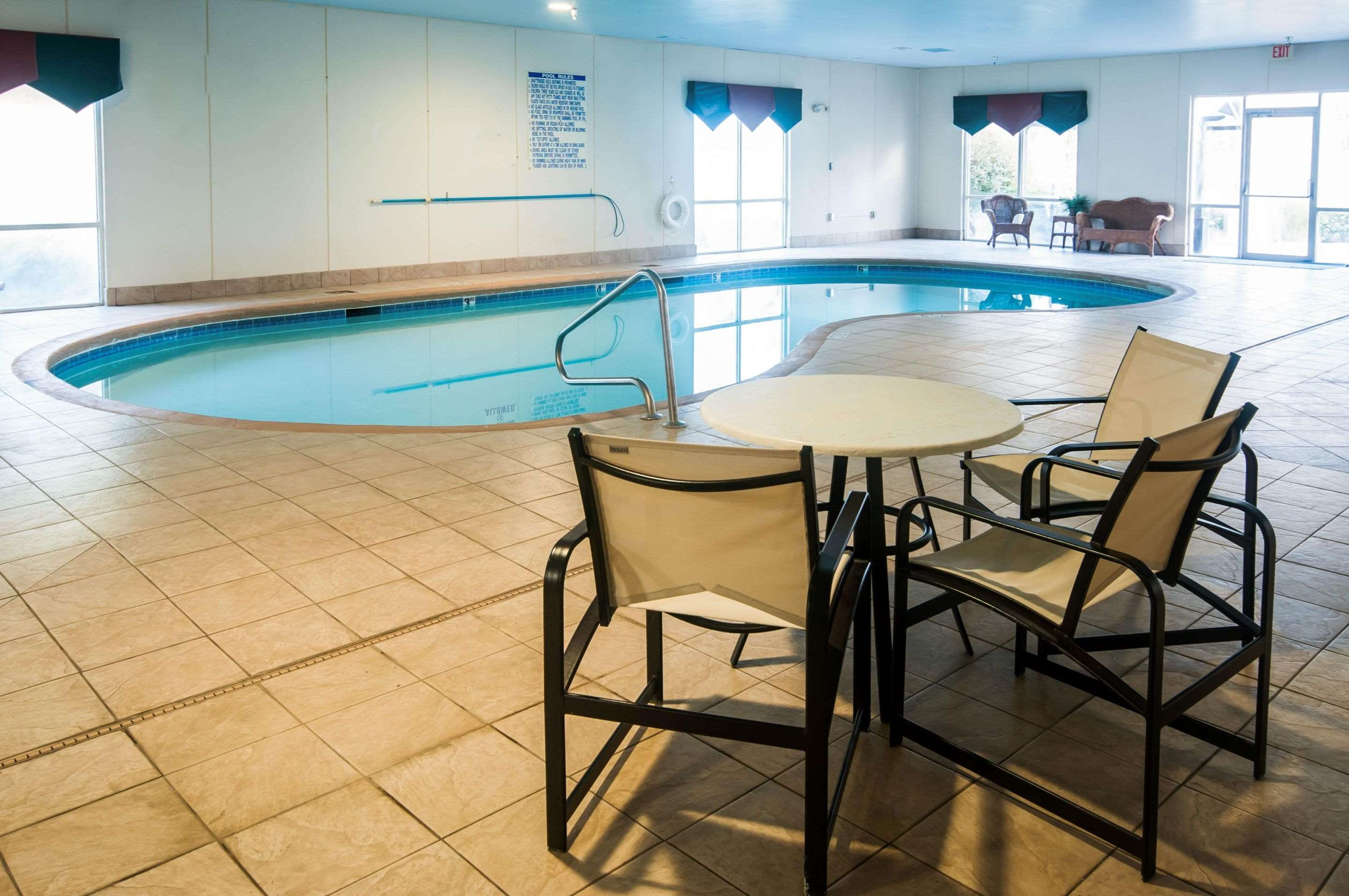 Indoor pool with table and chairs