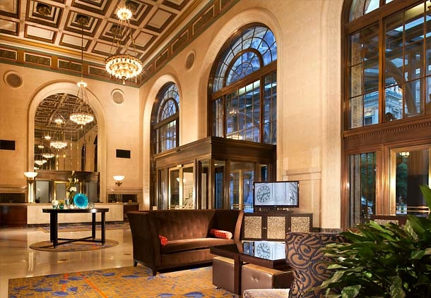 The lobby at the Courtyard Philadelphia Downtown calls back to 1926 grandeur with polished stone and coffered plaster ceiling.
