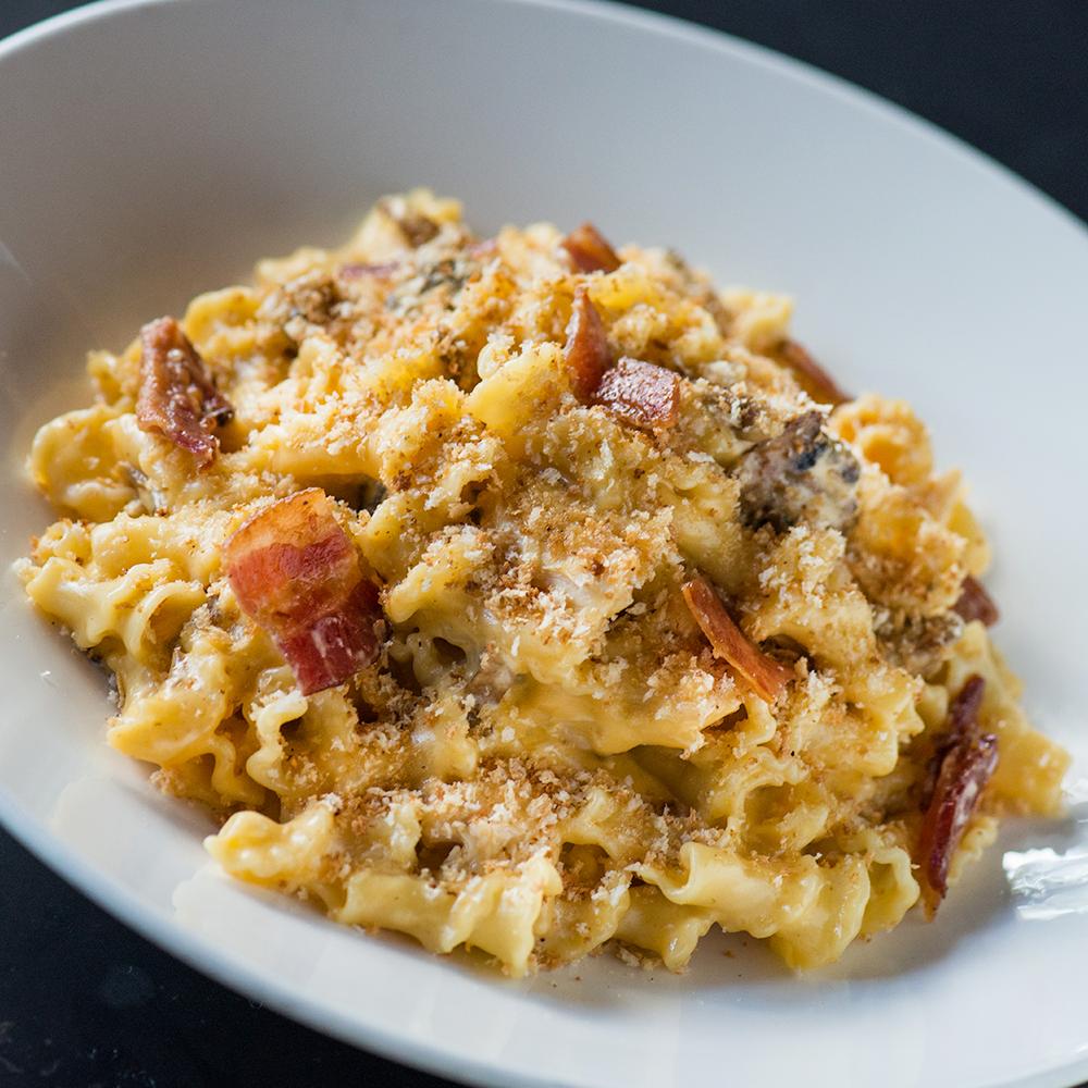 [Mac + Cheese]² - With bacon, chicken, crimini, shiitake & oyster mushrooms, truffle oil, parmesan, panko cheddar crust.