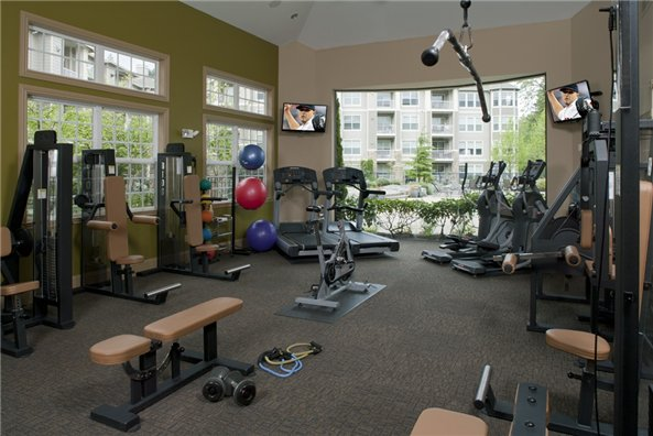 The Estates at Cougar Mountain - Issaquah, WA - Get a heart pumping workout in our premier fitness center.