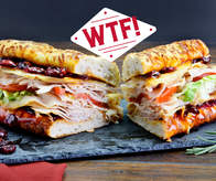 The new Winter Turkey Feast (WTF). The sandwich 2020 needed, the flavors you crave. Get your oven-roasted turkey, melty provolone, tart Ocean Spray craisins, tangy honey-french dressing, crisp lettuce, juicy tomato all piled high on our toasty artisan rosemary parmesan bread now in-store or at delivery.quiznos.com