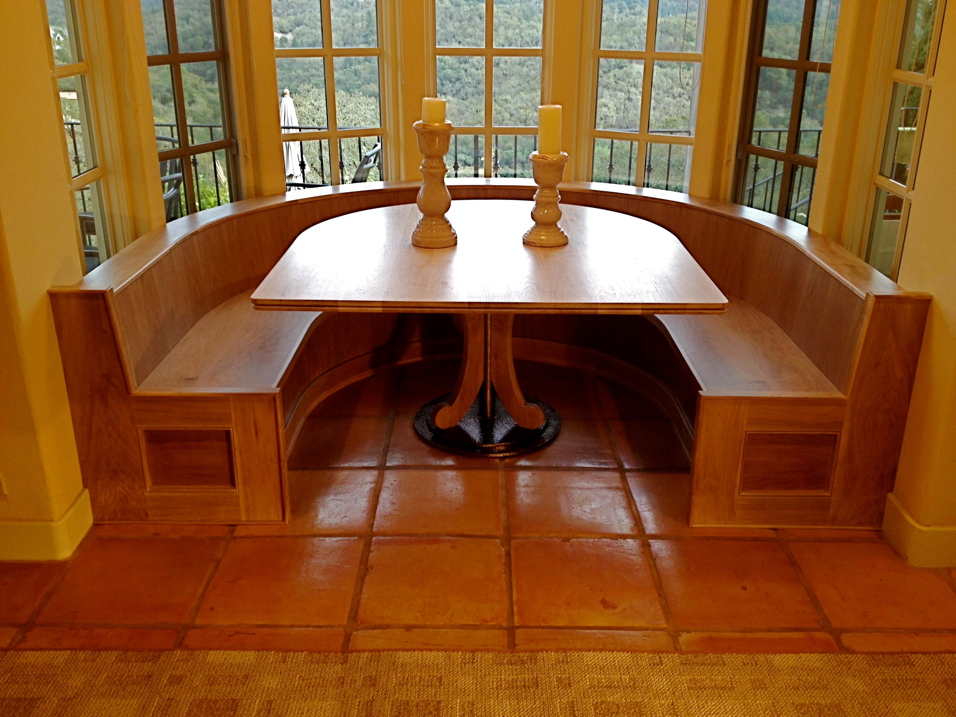 Custom built in banquette and table of bleached Walnut, designed and handcrafted by Philip Snyder of PS Woodworking elegantly utilizes maximum space, storage and comfort in this nook while adding an artistic showpiece to your home or business.