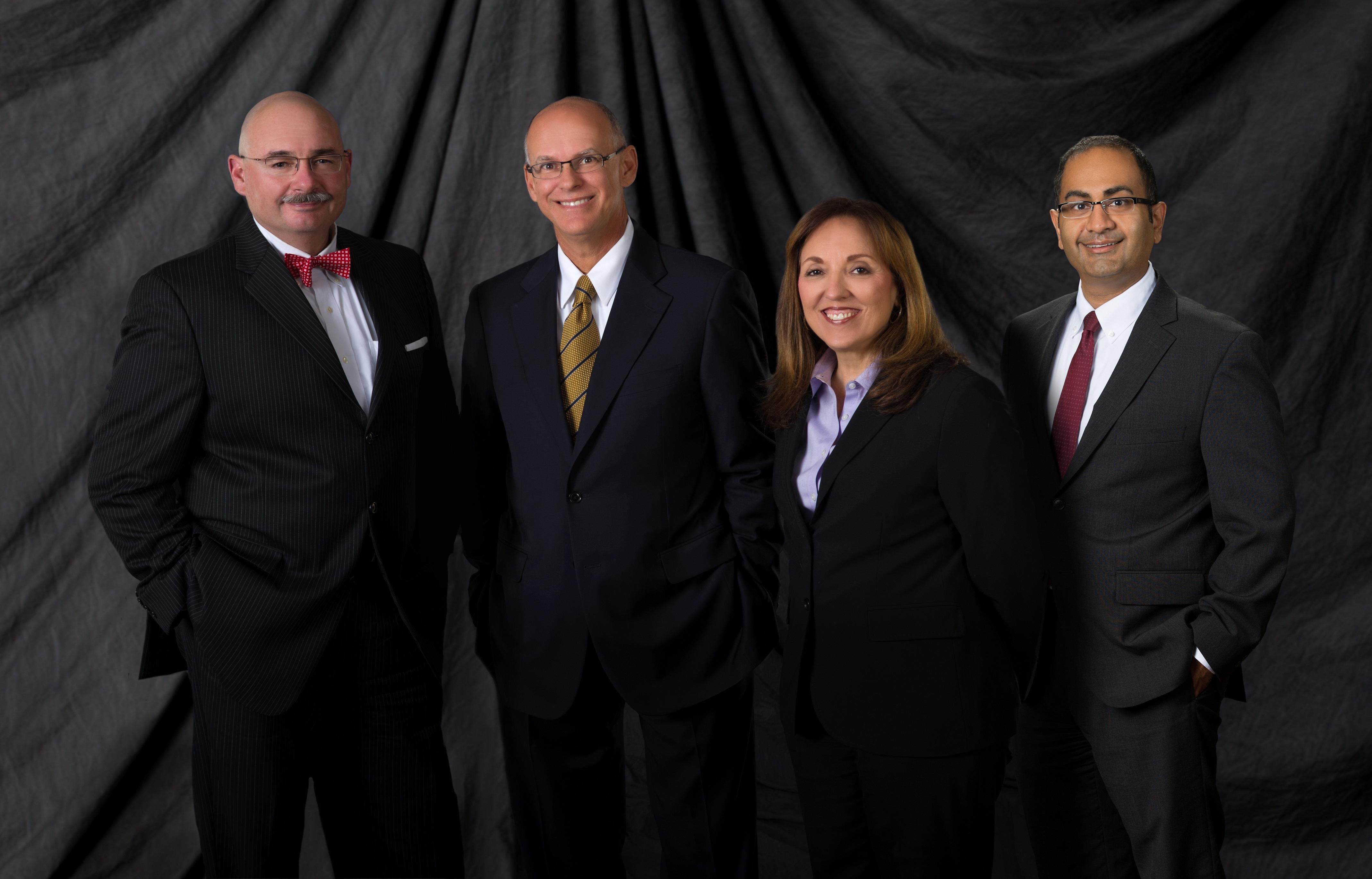 Escobar & Associates, P.A. From L to R Dino Michaels, Richard Escobar, DeeAnn Athan and Rupak Shah