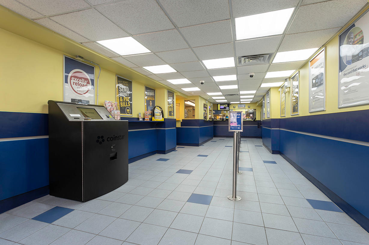 Inside view of customer line area and Coinstar machine for PAYOMATIC store located at 94 Eight Ave New York, NY 10001