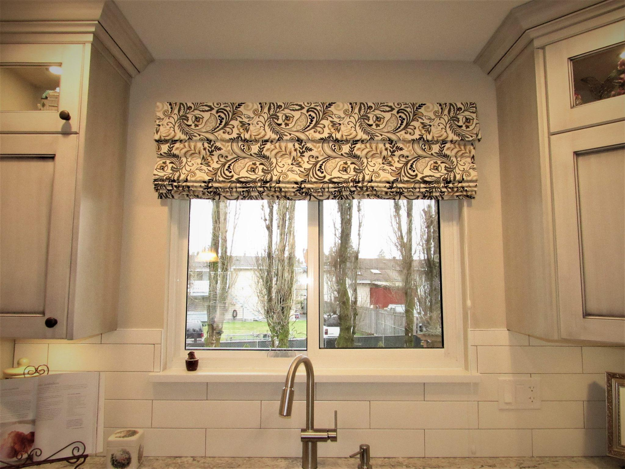 Budget Blinds of Delta, South Surrey and White Rock in Delta: Kitchen Roman Shade: Having a soft treatment in a kitchen window is the biggest trend right now. Choose a pattern that compliments your kitchen decor and ads a pop of design