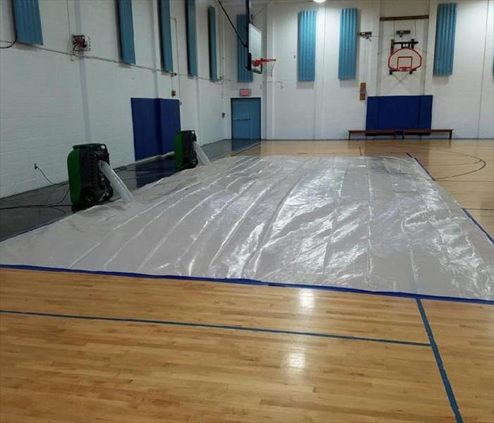 "Crew Chief Tim Crain ""tented"" this gymnasium floor in St Petersburg, and pumped in warm dehumidified air to dry and return to it's pre-loss condition. Would you like to guess what the cost would have been to replace this entire hardwood floor? Email your best estimate to: buddyg@SERVPROlargo.com. The closet entry wins a $25.00 Visa gift card! (727)586-0060"