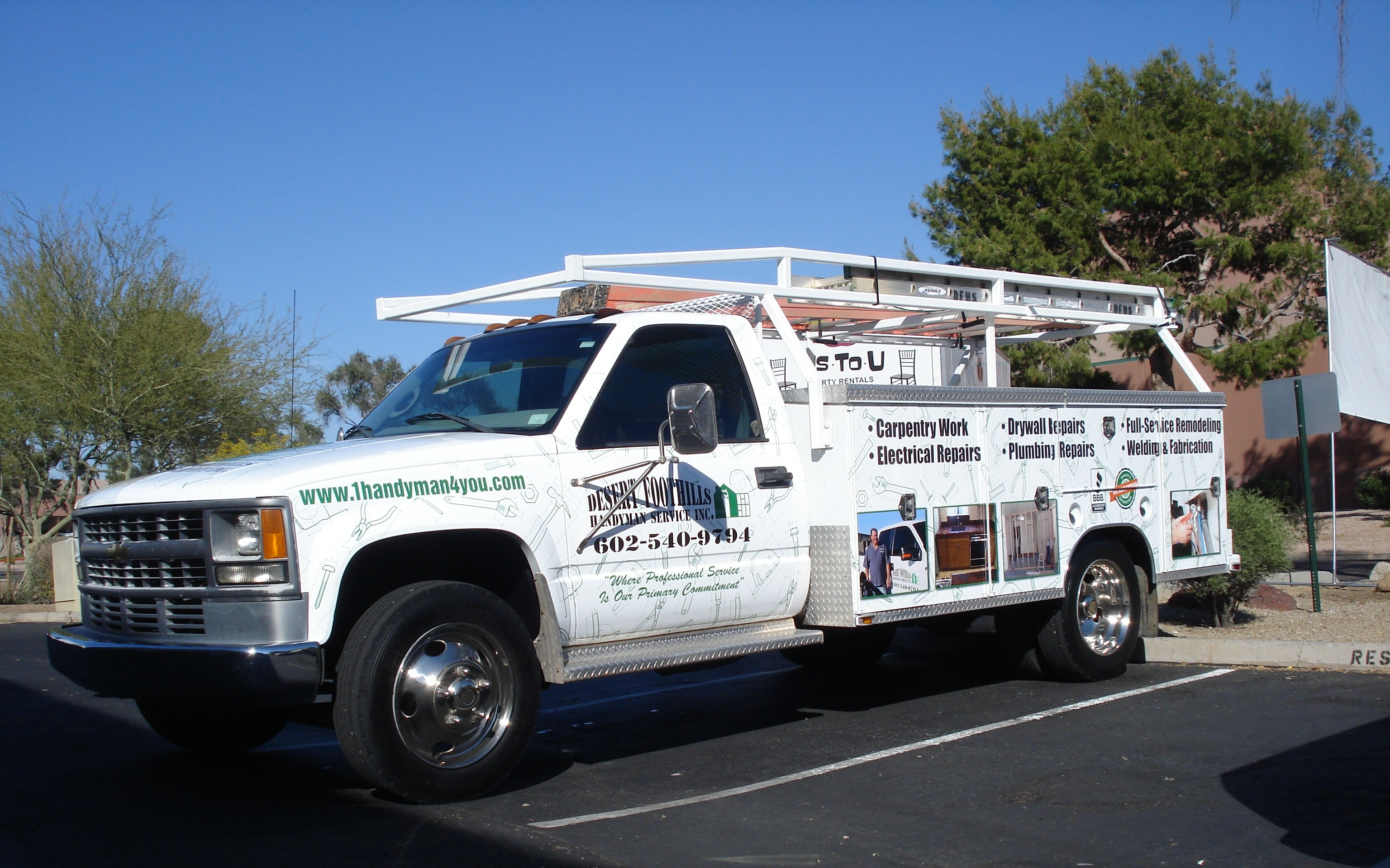 Fast trac designs vehicle wraps screen printing coupons for Landscaping rocks yuma az
