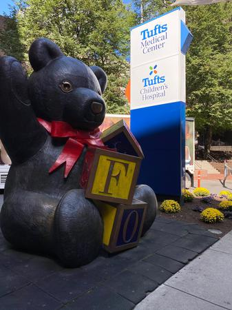 Bear in front of the new Tufts Children's sign