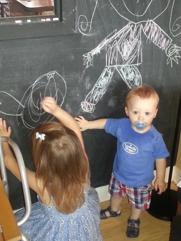 Happy adjusted kiddos! Two of our small patients make beautiful pictures on our chalk wall.
