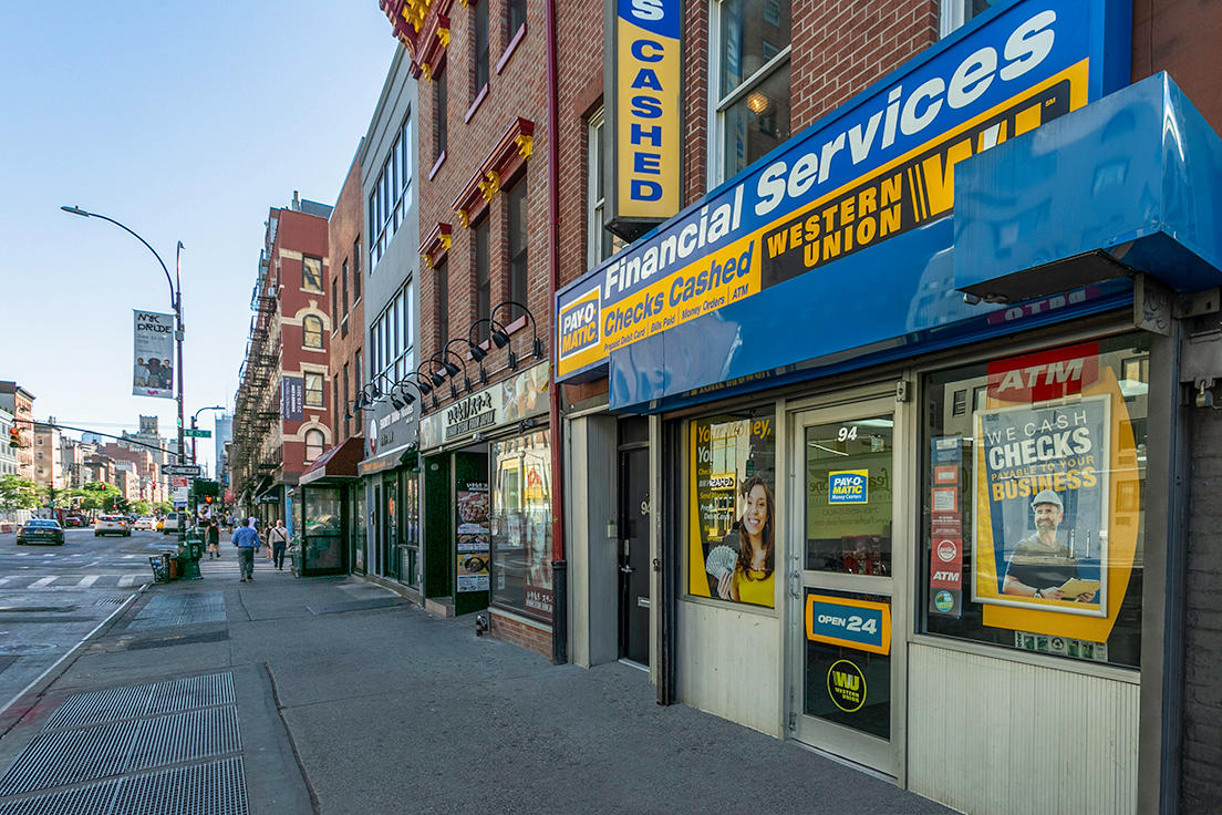 External view from sidewalk of PAYOMATIC store located at 94 Eight Ave New York, NY 10001