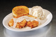 Chicken Fried Chicken - Tender chicken breast hand-dipped in buttermilk and seasoned flour, fried to a deep golden brown. Served with cream gravy and choice of side.