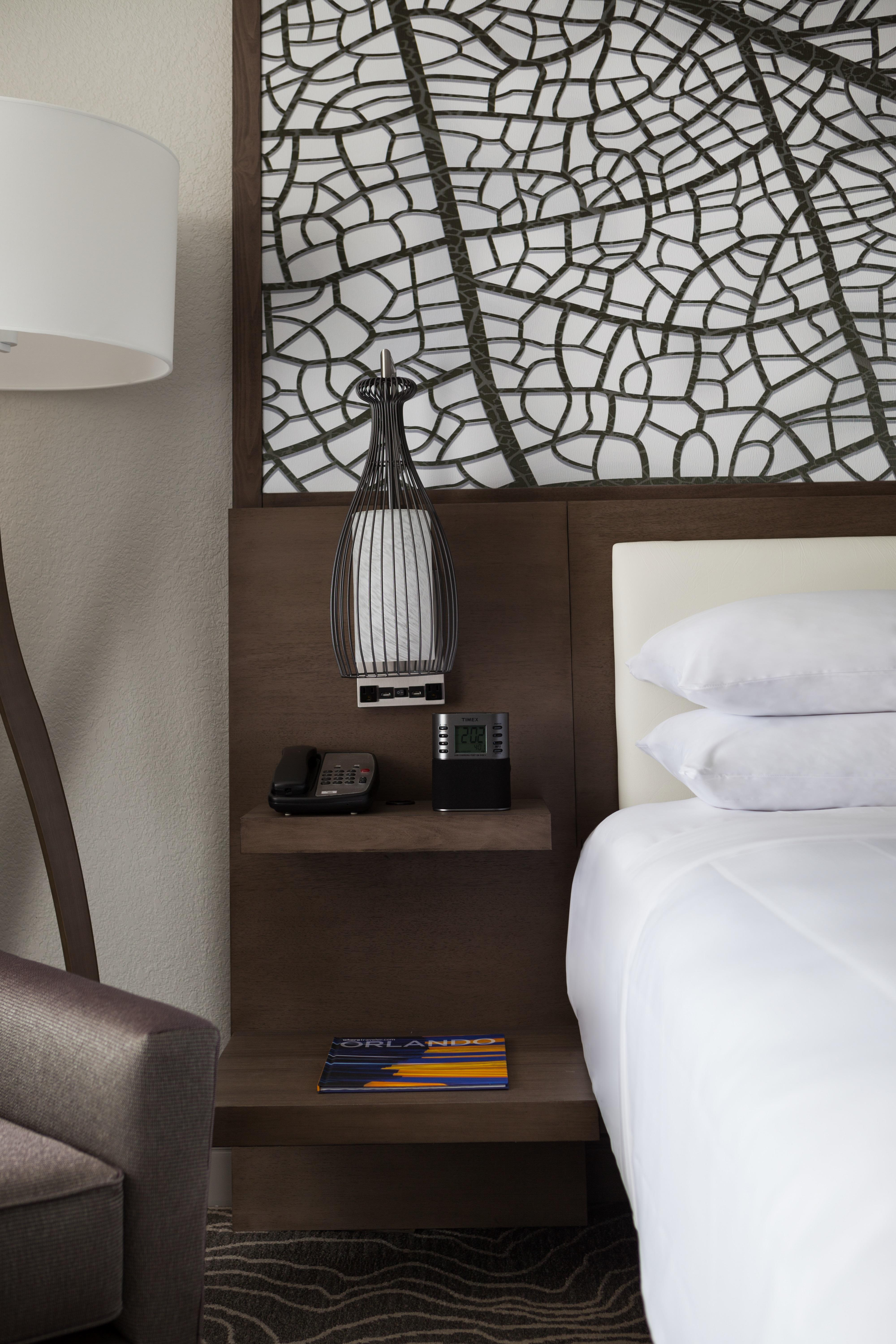 Our hotel rooms feature modern décor, lighted headboards and cutting-edge technology.