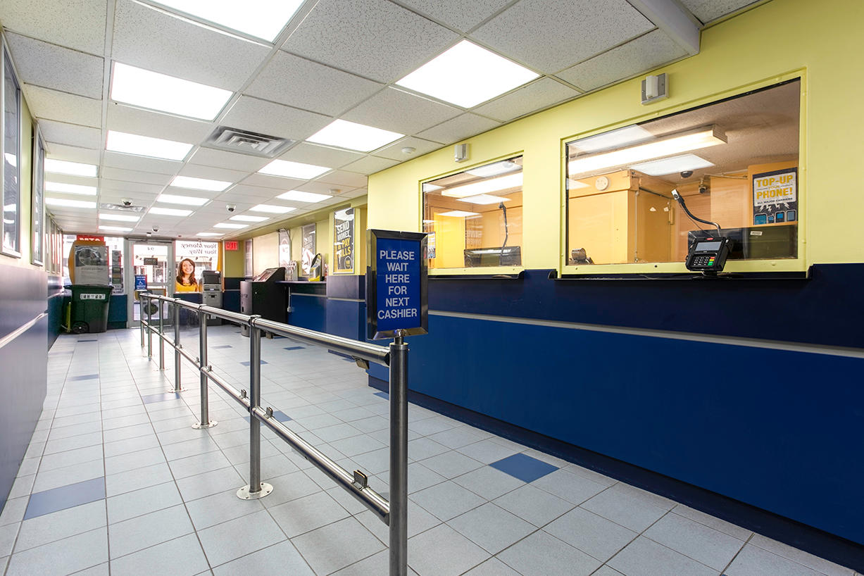 Inside view of customer line area for PAYOMATIC store located at 94 Eight Ave New York, NY 10001