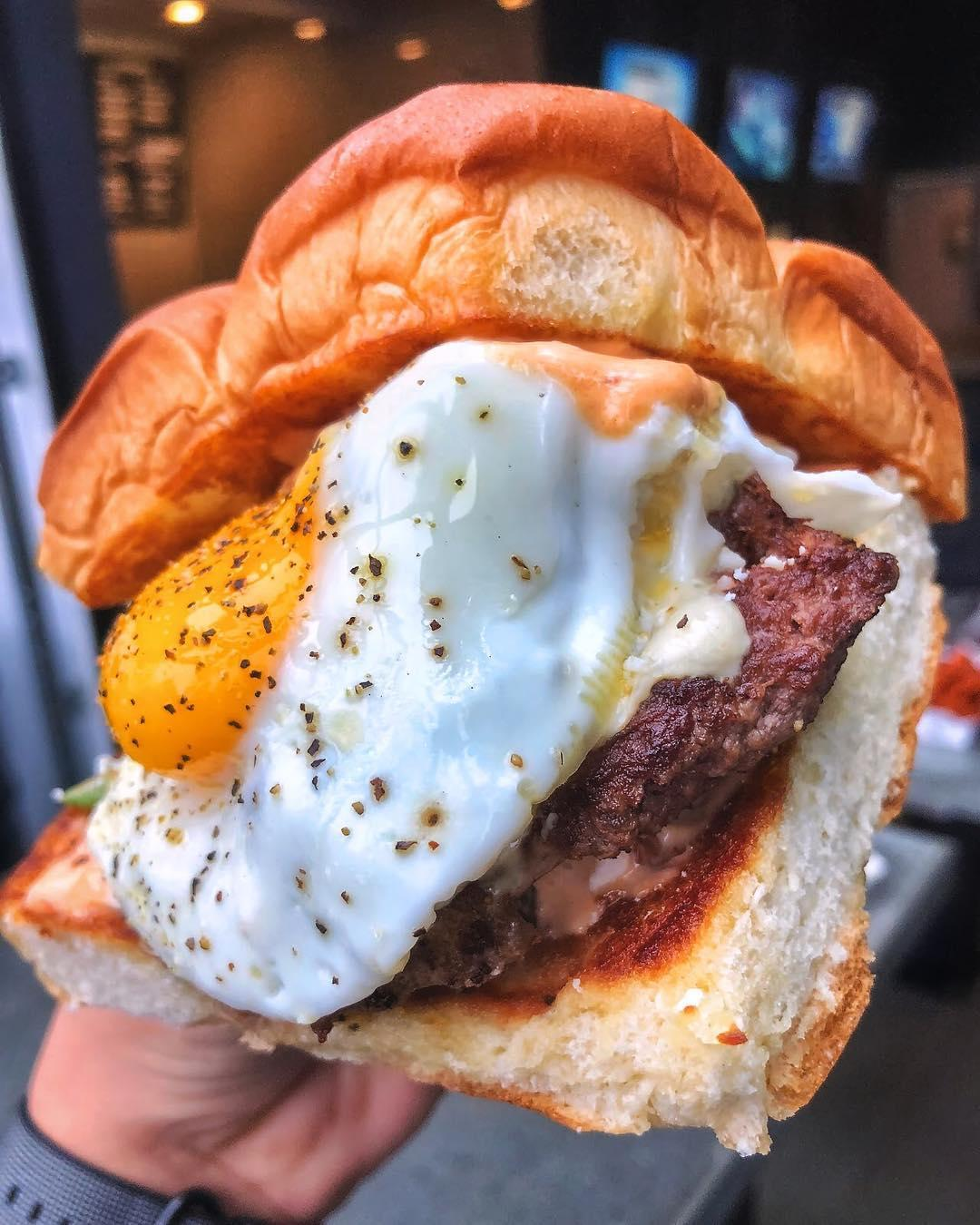 THE HANGOVER – white american cheese, smoked bacon, haus chili, fried egg, mayo; on grilled king's hawaiian rolls