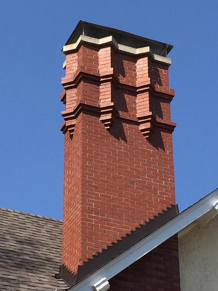 Rebuilt to original specification intermingling existing  brick with new brick matching original mortar joints and color.