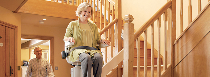 Orange used Electric Stair Lifts home in indoor, outdoor and custom curved models.  Home residential straight rail lifts; outside exterior outdoor stairlift stairway staircase models; and custom curved chairlifts.