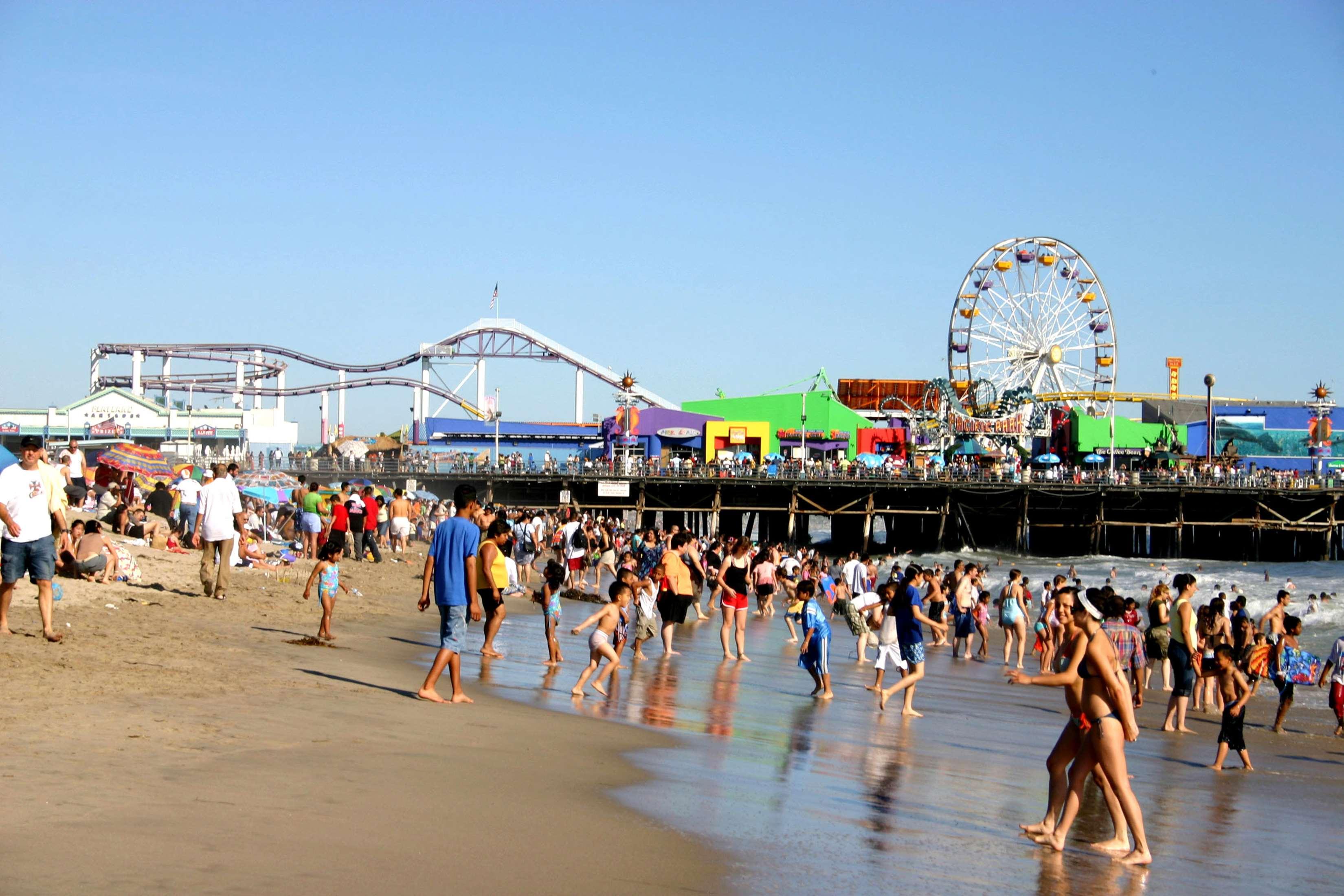 Beachgoers And Santa Monica Pier