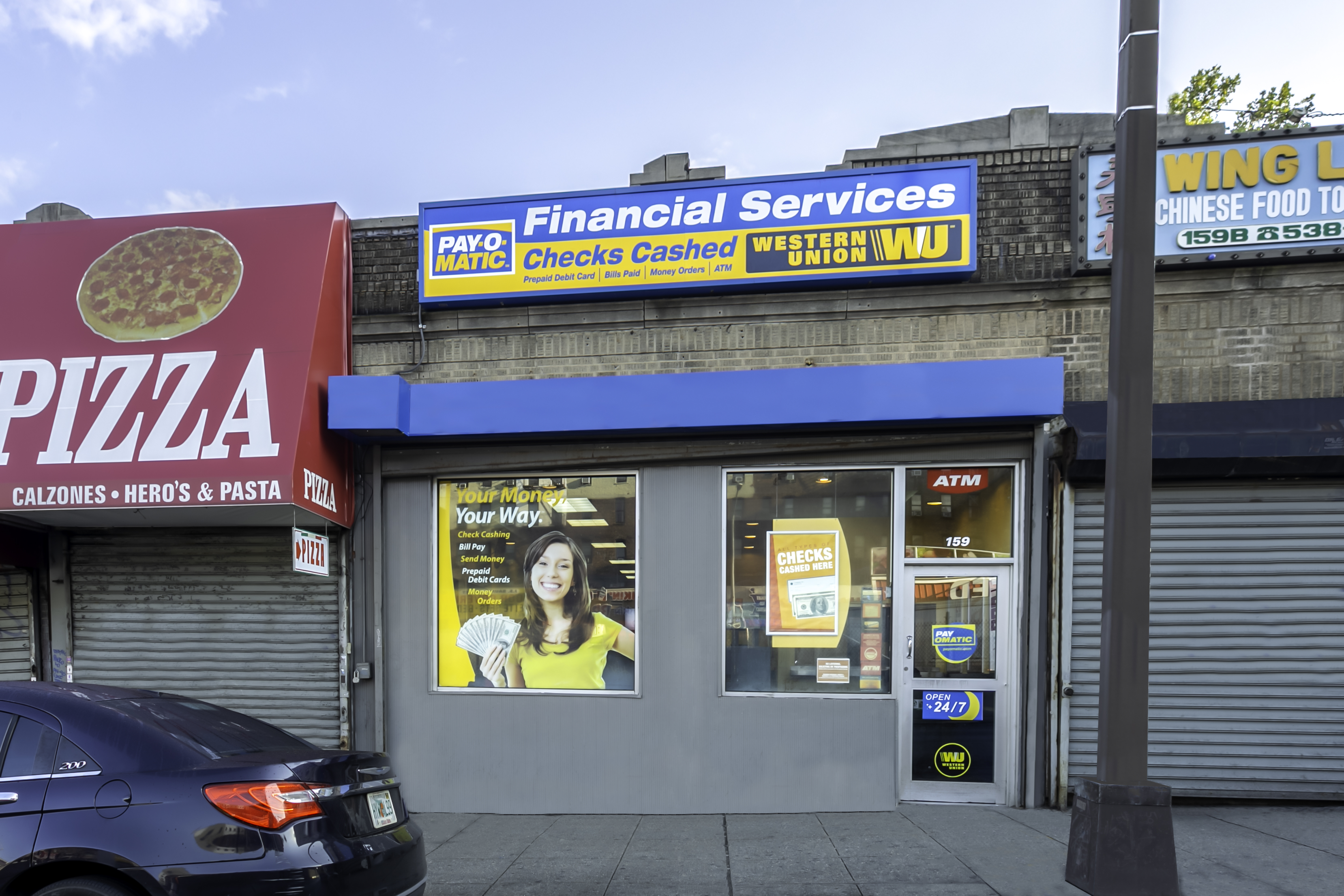 Exterior view from street of PAYOMATIC store located at 159 East 170th St Bronx, NY 10452