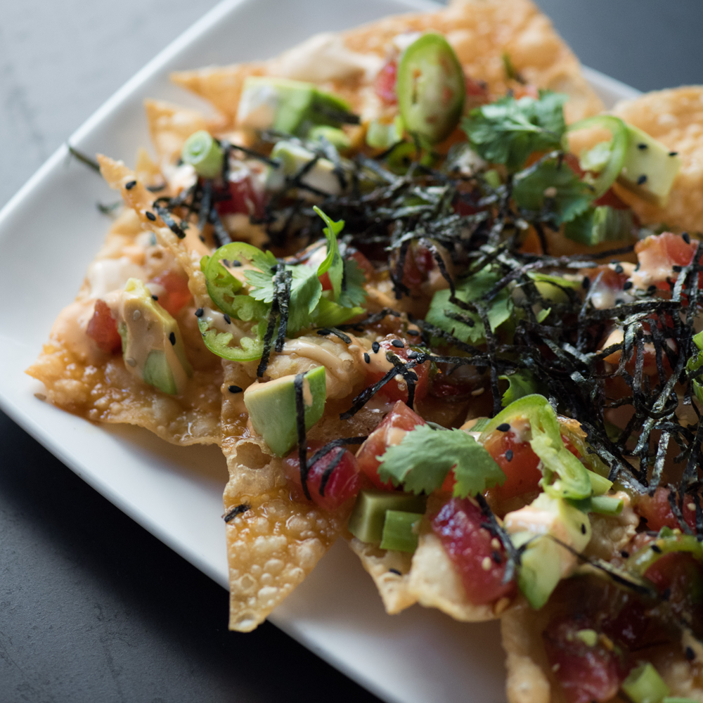 Satisfy your tastebuds with 1/2 off select appetizers, like our Poke Nachos, and all pizzas during Happy Hour and Late Night Happy Hour.