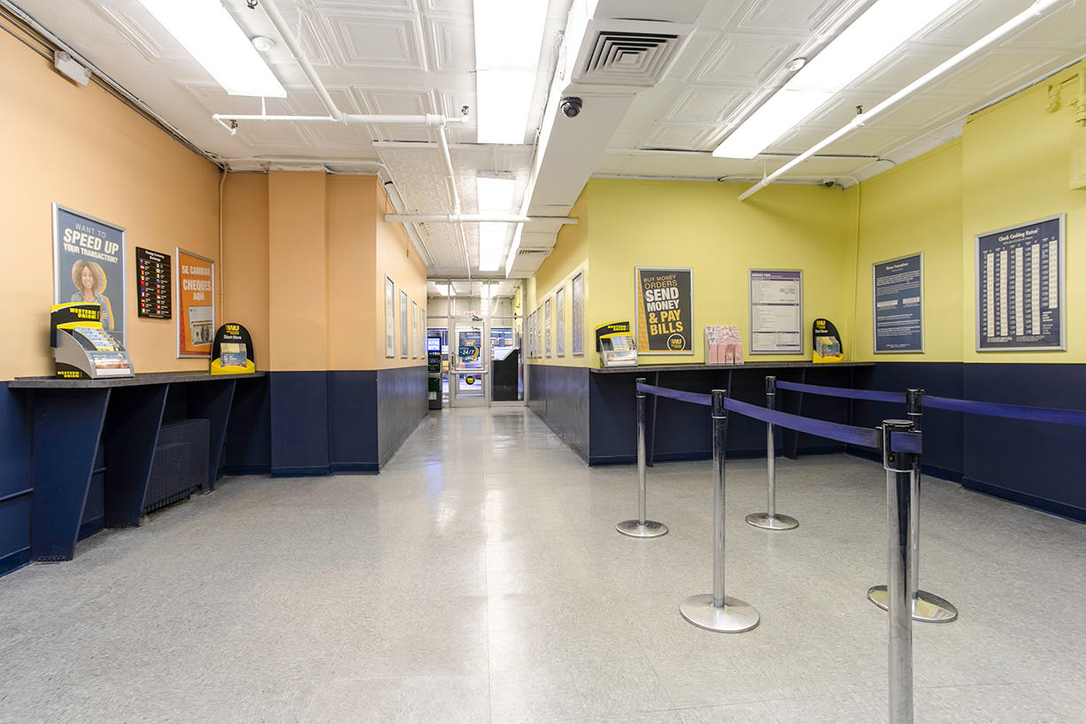 Customer waiting area and entrance inside PAYOMATIC store located at 115 West 23rd St New York, NY 10011
