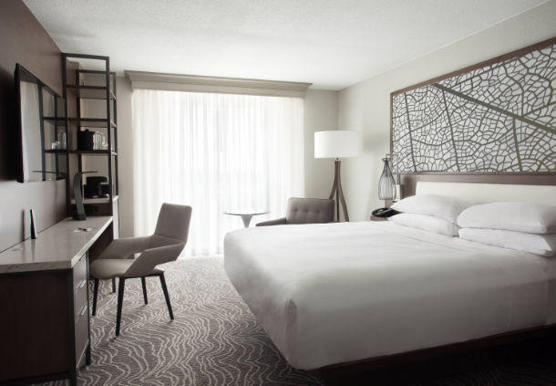 Enjoy natural light through soundproof floor-to-ceiling windows in our spacious king guest room.