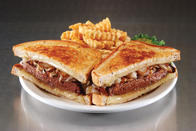 Patty Melt - Half-pound steak burger* with Swiss cheese and grilled onions, served on grilled deli rye.