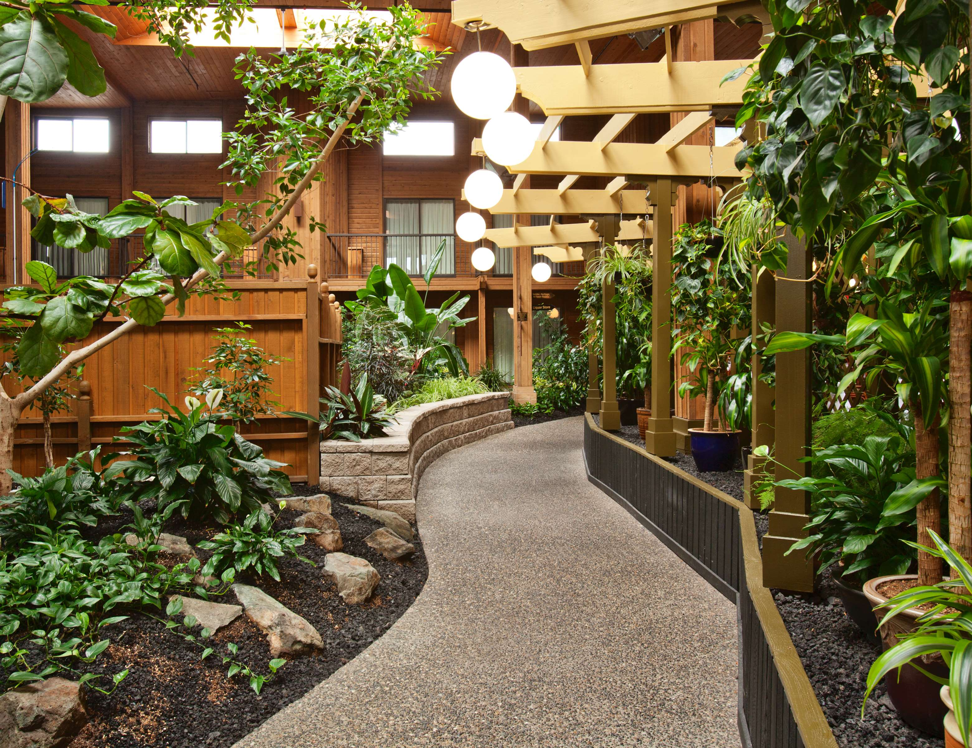 Surestay Hotel By Best Western Chilliwack in Chilliwack: Pathway through the Tropical Atrium Garden