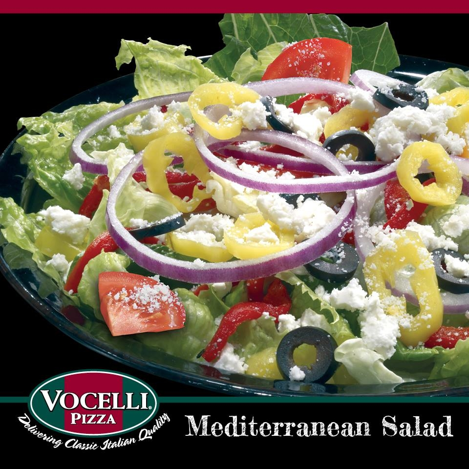 Mediterranean Salad: Fresh Greens with red onions, roasted red pepper, black olives, tomatoes , banana peppers, feta cheese and Pecorino Romano cheese.