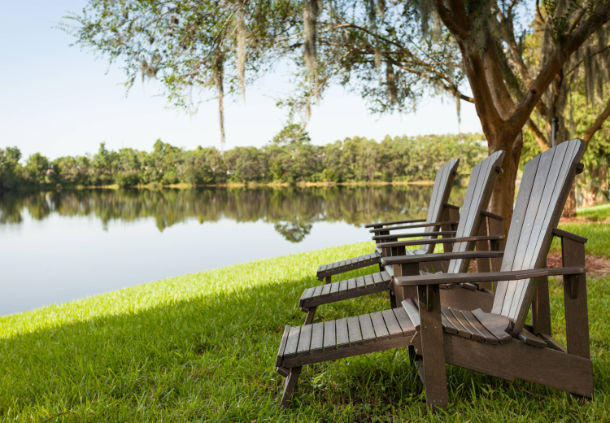 Enjoy serene views of Lake Michelle from comfortable  Adirondack chairs.