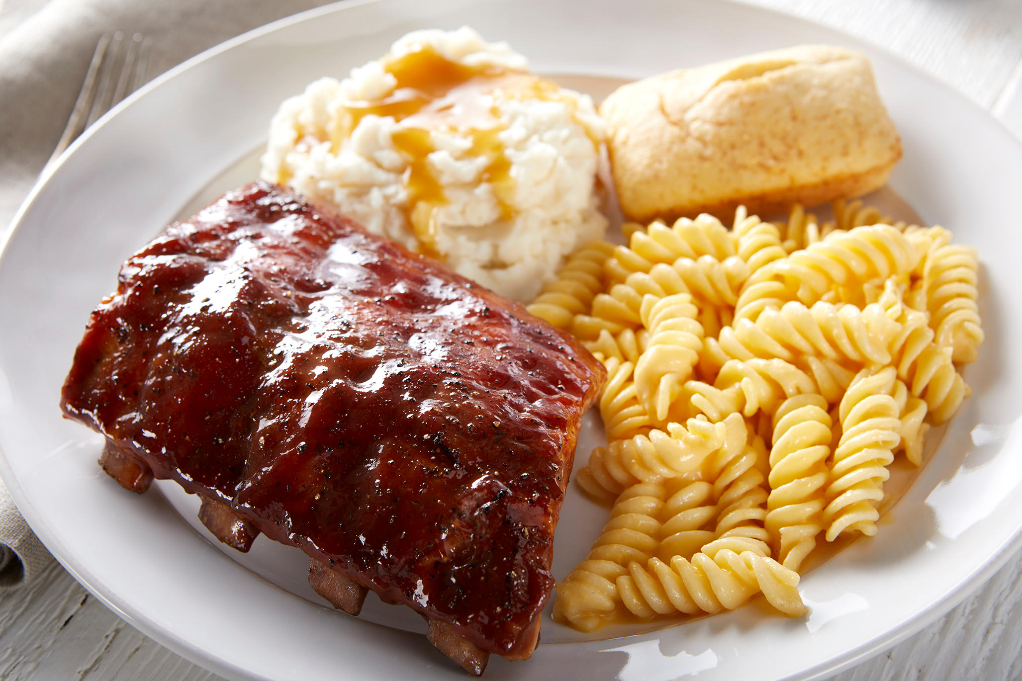 New! Baby Back Ribs. Our slow-cooked, fall-off-the-bone Baby Back Ribs are seasoned then brushed with sweet hickory BBQ sauce.