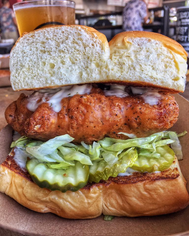 BAD MUTHA CLUCKA – beer battered or grilled chicken breast, lettuce, pickles, miso ranch; served on grilled king's hawaiian rolls; created by Chef Ilan Hall