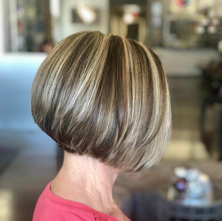 Precision Hair Cut with High-lights on Choc Brown Hair.