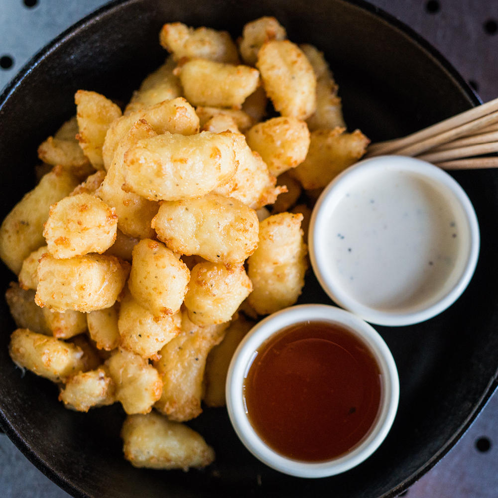Don't be shy and give the Wisconsin Fried Cheese Curds a try.