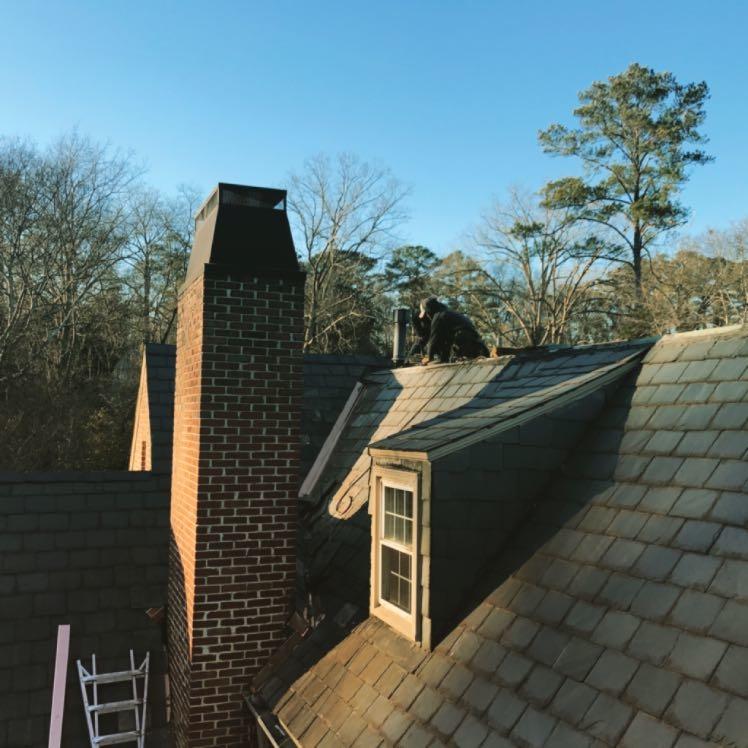 Slate roof repair in Mountain Brook, Alabama by Capstone Roofing, LLC.