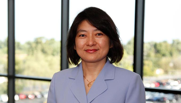Xiaoqi K Sun