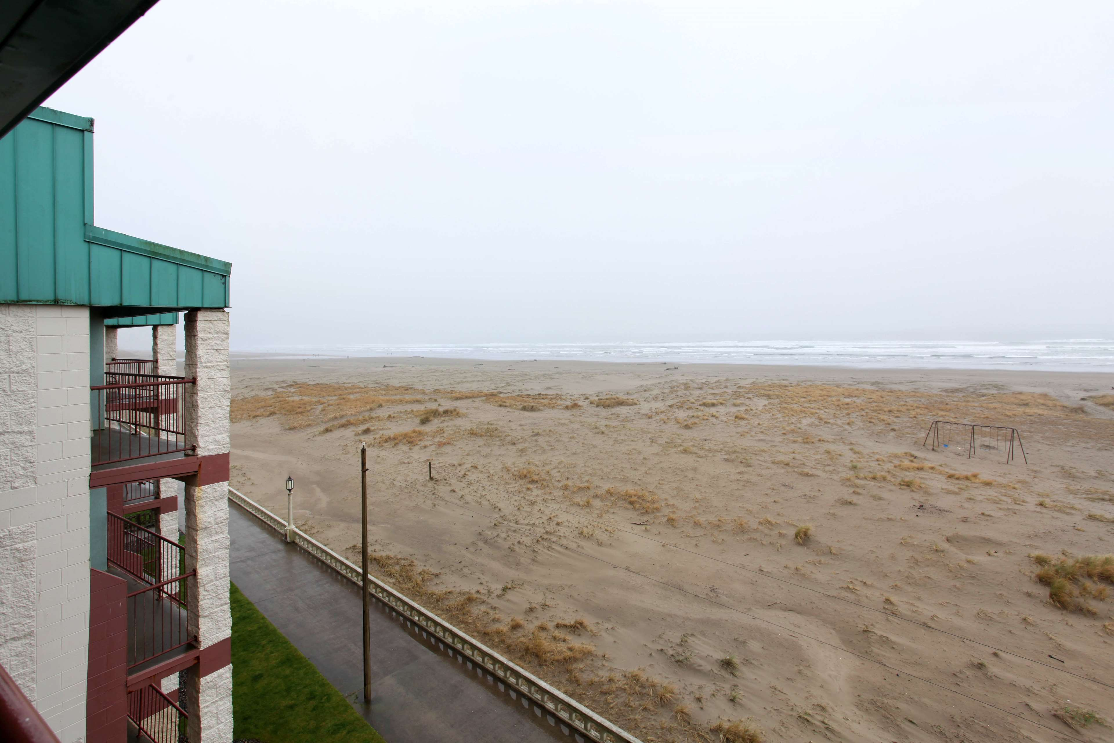 seaside in vacation cove beach sandy condo of rentals inn oregon and homes comforter comfort