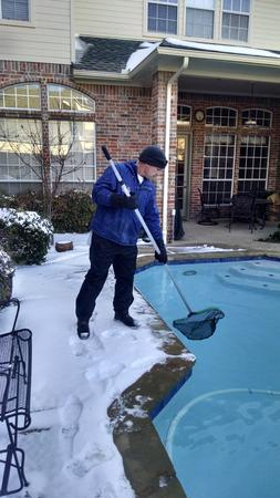 Pool Troopers Service Technician Working in the Snow