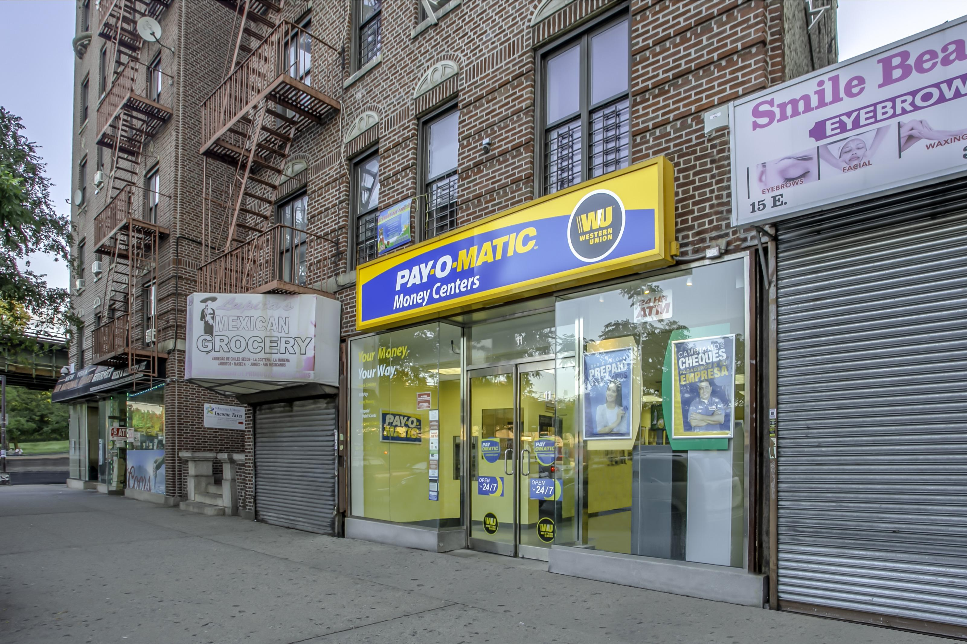 Exterior view from sidewalk of PAYOMATIC store located at 11 East Gunhill Road Bronx, NY 10467