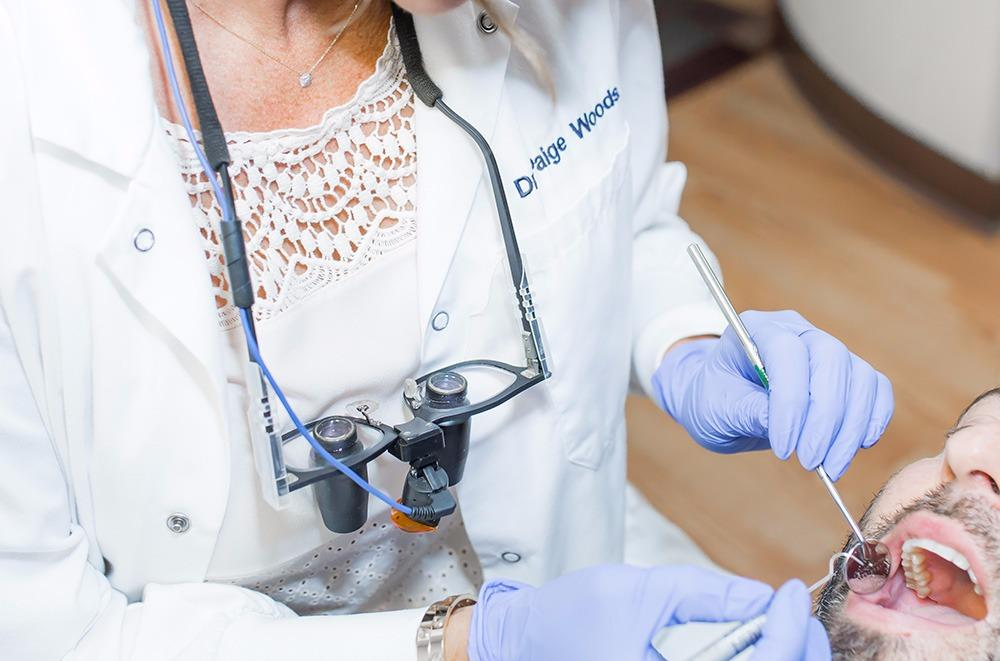 Holistic Dentist, Dr. Paige Woods Examining Patient