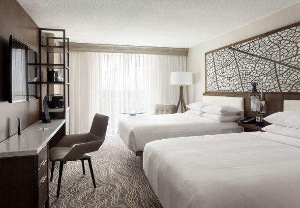 In addition to two queen beds, these hotel rooms offer a workspace and a flat-screen TV.