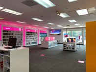 Interior photo of T-Mobile Store at E Colfax Ave & Glencoe St, Denver, CO